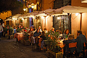 People sitting on the terrace of restaurant da Otello in the evening, Trastevere, Rome, Italy, Europe