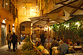People sitting on the terrace of restaurant alle Fratte at Via delle Fratte, Trastevere, Rome, Italy, Europe