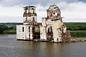 Ruin of a church in the flooded area of Rybinsk reservoir, Russia