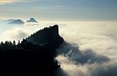 Kampenwand and Hochlerch above fog bank, Chiemgau range, Chiemgau, Upper Bavaria, Bavaria, Germany