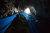 Rowing boat inside the Blue Grotto, Capri, Campania, Italy
