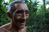 Cheerful Amazonian Man in the rainforest, Combo Island, near Belem, Para, Brazil, South America