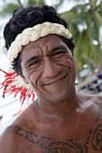Friendly Polynesian man with traditional headdress, Fakarava, The Tuamotus, French Polynesia
