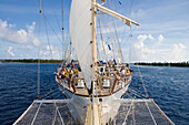 Sailing Cruiseship Star Flyer (Star Clippers Cruises) sails through Avatoru Pass into Rangiroa Atoll, Rangiroa, The Tuamotus, French Polynesia