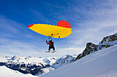 A man with snowboard using a Woopy-Jump, Grimentz, Valais, Switzerland