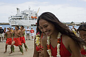 Laughing woman and men dancing welcome dance Aranui, Ua Pou, Marquesas, Polynesia, Oceania