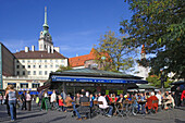 People at Viktualienmarkt in front of the tower of Alter Peter, Munich, Bavaria, Germany