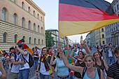 German soccer fans celebrating on Leopoldstrasse, Maxvorstadt, Munich, Bavaria, Germany