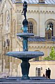 Marstallplatz with fountain Kronprinz-Rupprecht-Brunnen and Church of All Saints, Munich, Bavaria, Germany