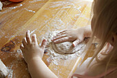 Hands of a child baking