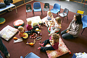 group of young children playing together in a music class