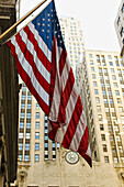 USA, Illinois, Chicago. Chicago Board of Trade building and carved name, exterior, USA flag foreground