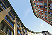 Massachusetts, Boston, Curved buildings in Seaport District, yellow and red brick, view looking up