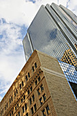 Massachusetts, Boston, Low stone building contrasted with glass and metal highrise, viewed from below