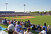 Kane County Cougars Class A professional baseball team home game, stands and field, infield, complete view of diamond, fans seated on grassy hill to view. Geneva. Illinois. USA.