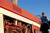 Farmer on tractor. Jefferson County, Nebraska. USA.
