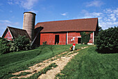 Agriculture, Animal, Animals, Barn, Barns, Color, Colour, Country, Countryside, Daytime, Dog, Dogs, Exterior, Farm, Farming, Farms, Human, Outdoor, Outdoors, Outside, People, Person, Persons, Pet, Pets, Red, Rural, J53-411693, agefotostock