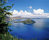 Summer clouds over Wizard Island from Discovery point (afternoon). Crater Lake National Park. Oregon. USA