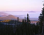 Three Fingered Jack and Mount Jefferson, Oregon Cascades at sunrise. Deschutes National Forest. Oregon. USA