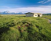 Historic Cunningham Cabin (Circa 1890). Teton Mountain Range, Grand Teton National Park. Teton County, Wyoming. USA.