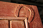 Aged, Chance, Close up, Close-up, Closeup, Color, Colour, Concept, Concepts, Corner, Corners, Daytime, Decoration, Detail, Details, Door, Doors, Exterior, Horizontal, Horseshoe, Horseshoes, Lintel, Lintels, Luck, Luckiness, Lucky, Old, Open, Outdoor, Out