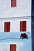 Clothesline hung up outside a house, Burano, Laguna, Veneto, Italy