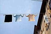 Clothesline hung up between houses, Chioggia, Venice, Laguna, Veneto, Italy