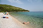 woman at beach, Dalmatia, Croatia