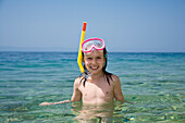Little girl with diving mask and snorkel, snorkeling in the sea, Croatia, Europe