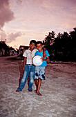 Maledivian Kids with football, Maldives, Indian Ocean, Meemu Atoll