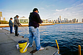 Anglers in the morning at waterside of Lake Michigan at Northerty Island Park, Chicago, Illinois, USA