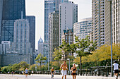 People jogging at Boardwalk on Oak Street Beach, Gold Coast, Chicago, Illinois, USA