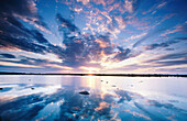 Sunset skies reflected in Tundra Lake near Hudson Bay. Churchill. Manitoba. Canada