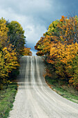 Country road and fall colour. Manitoulin Is., Ontario, Canada