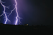 Anger, Bolt, Bolts, Color, Colour, Dark, Darkness, Electricity, Energy, Exterior, Horizontal, Light, Lightning, Meteorology, Natural phenomena, Natural phenomenon, Nature, Night, Nighttime, Outdoor, Outdoors, Outside, Power, Rage, Storm, Storms, Stormy, W