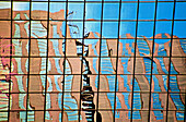 Reflection of office building under construction