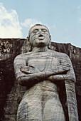 Ancient architecture. Upper portion of the figure, Anand. Gal Vihara. Polonnaruva, Sri Lanka.