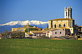 Púbol in winter with Pyrenees mountains in background, La Pera. Baix Empordá, Girona province, Spain