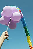 Balloon, Balloons, Blue, Blue sky, Childhood, Color, Colored, Colorful, Colors, Colour, Coloured, Colourful, Colours, Contemporary, Daytime, Exterior, Flight, Flights, Fly, Flying, Hand, Hands, Height, Hold, Holding, Human, Imagination, Infantile, Leisur
