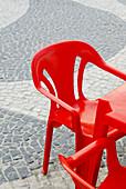 Cafe terrace, Cafe terraces, Chair, Chairs, Color, Colour, Concept, Concepts, Daytime, Detail, Details, Empty, Exterior, Mosaic, Mosaics, Outdoor, Outdoor cafe, Outdoor cafes, Outdoors, Outside, Plastic, Red, Square, Squares, Table, Tables, Urban, Vertic