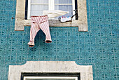 Laundry hanging out window. Lisbon. Portugal