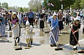 Street washing, a dutch custom in preparation for the Tulip Time parade in Pella, Iowa, USA.
