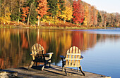 Adirondack chairs in a dock in autumn. Starlight. Pennsylvania. USA