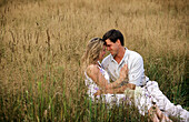 Couple hugging in a field