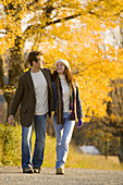 Couple walking on country road on a sunny day