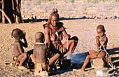 Himba wife with children. Kaokoveld. Namibia.