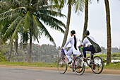 Students on bicycles near Hoi An.