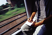 Adult, Adults, Anonymous, Color, Colour, Compose, Composition, Contemporary, Daytime, Fast, Horizontal, Human, Indoor, Indoors, Inspiration, Interior, Leisure, Male, Man, Men, Motion, Movement, Moving, Notebook, Notebooks, One, One person, Passenger, Pas