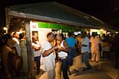 Couple Dancing at  Friday Market at night, Oistins, Barbados, Caribbean