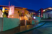Exterior view of restaurant Cafe Sol at night, St. Lawrence Gap, Barbados, Caribbean